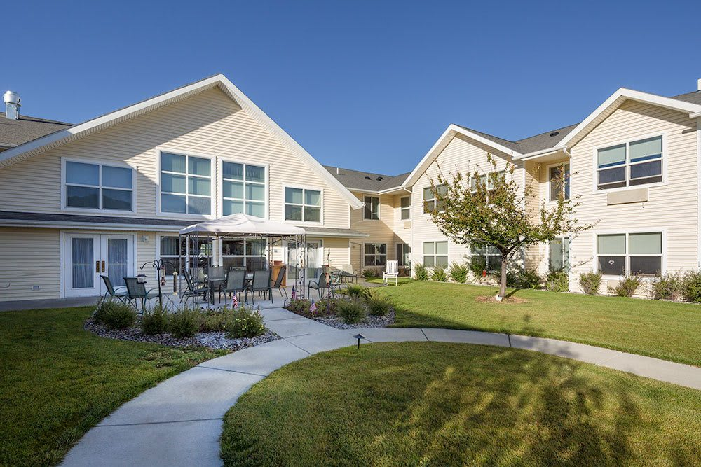 Our senior living community features a sprawling lawn and patio