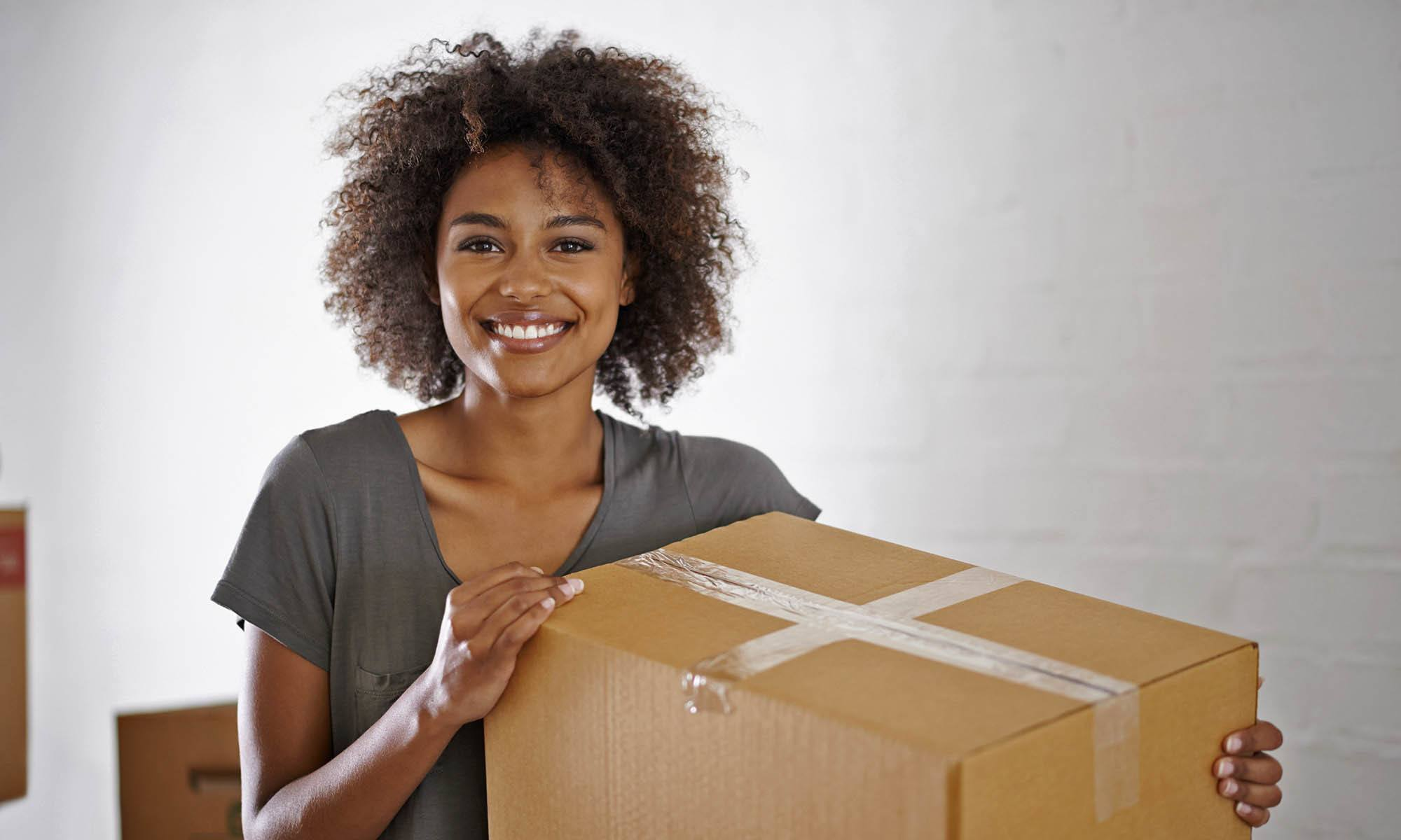 Woman packing boxes for storage at First Rate Storage in San Leandro, CA