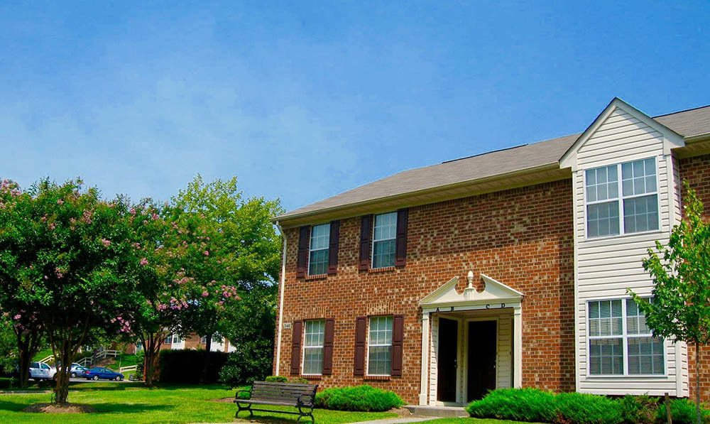 exterior with trees of Meadowridge Apartments in Franklin, VA