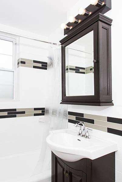 Bathroom sink and shower at Parktowne Apartments