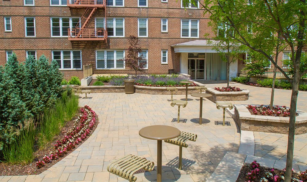 Parktowne Courtyard With Tables in Highland Park, NJ