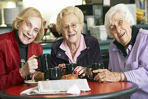 Seniors enjoying coffee at The Amber