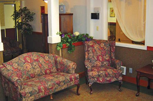 formal sitting area in apartment at SouthTowne Memory Care