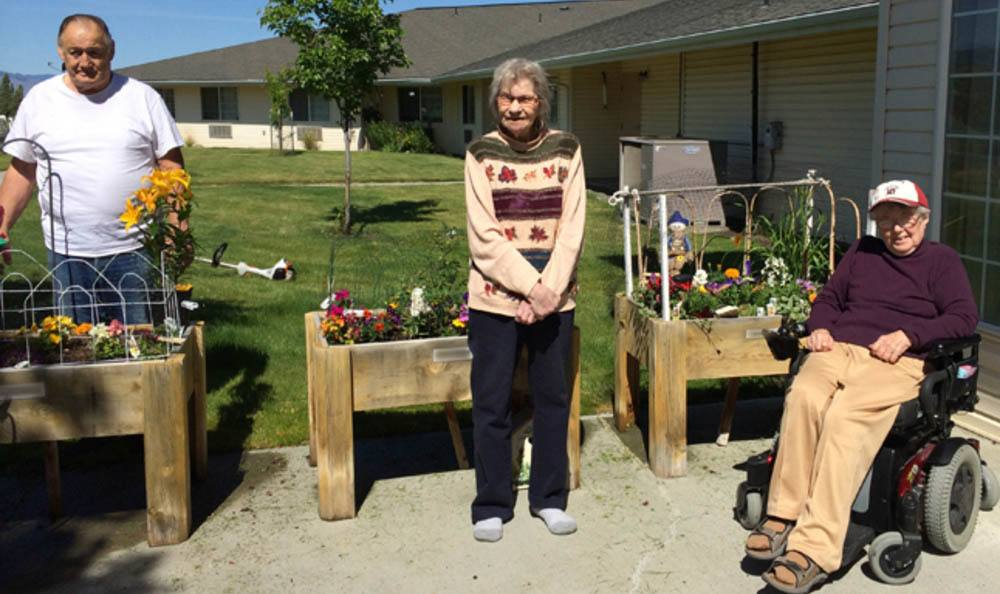Friends garden together at senior living in John Day