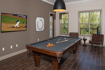Clubhouse with pool table at apartments in Huntersville