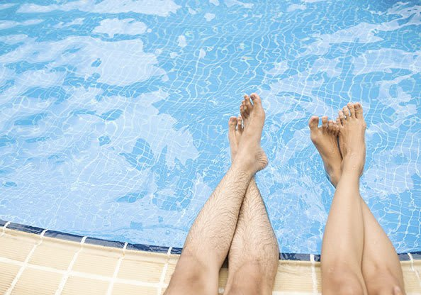 Enjoy our community swimming pool at Island Club Apartments