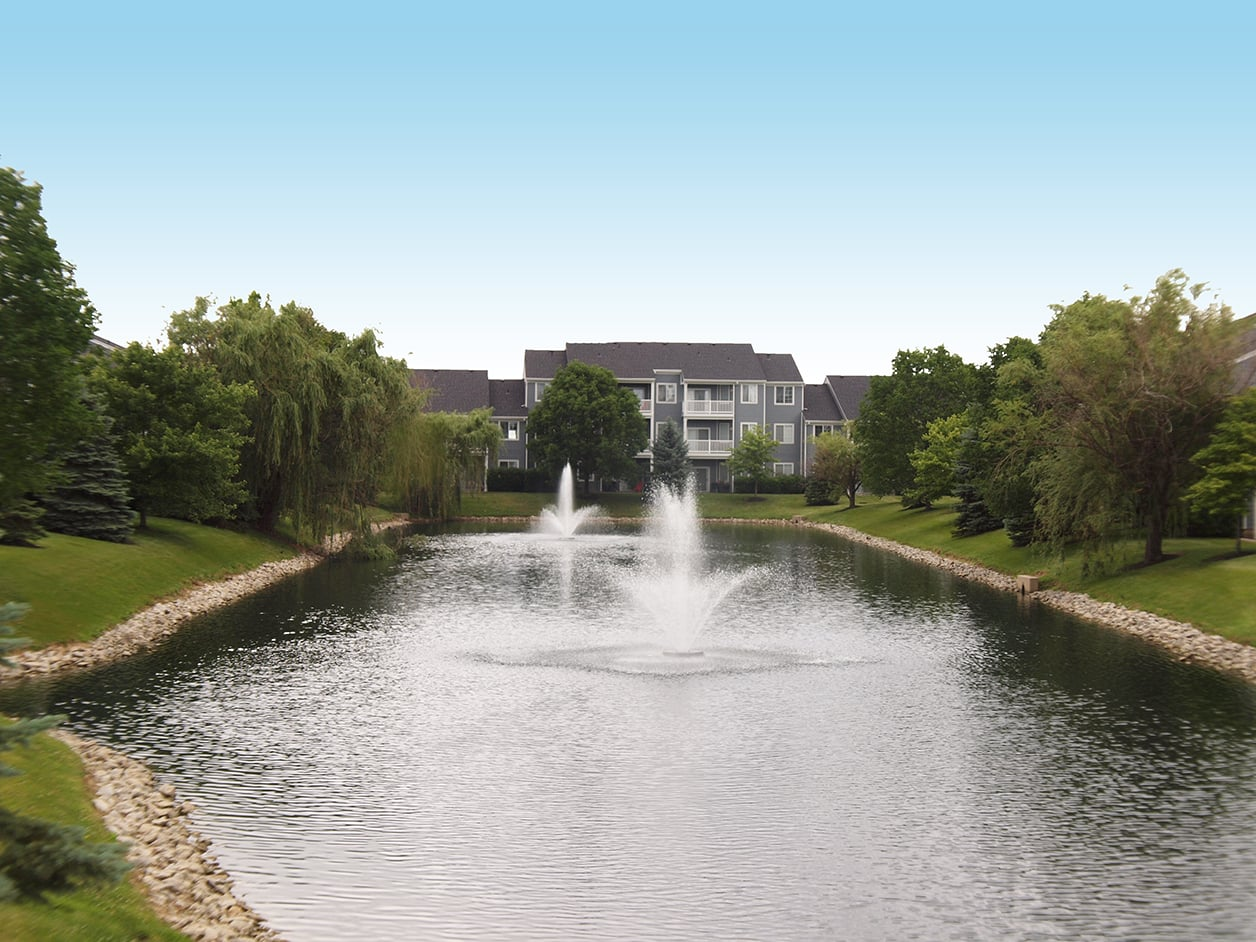 Outdoor space featuring pond with fountain at Sterling Lakes in Mason, Ohio