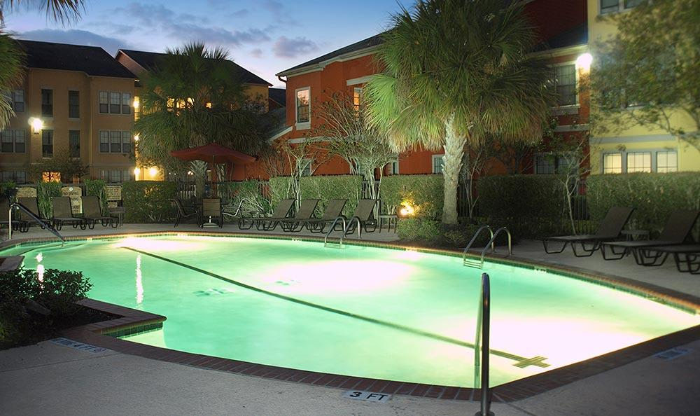 Pool view at night at Summerwind Apartments