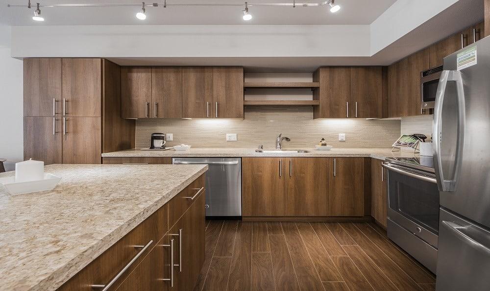 Kitchen with stainless steel appliances at The Meyden in Bellevue, Washington