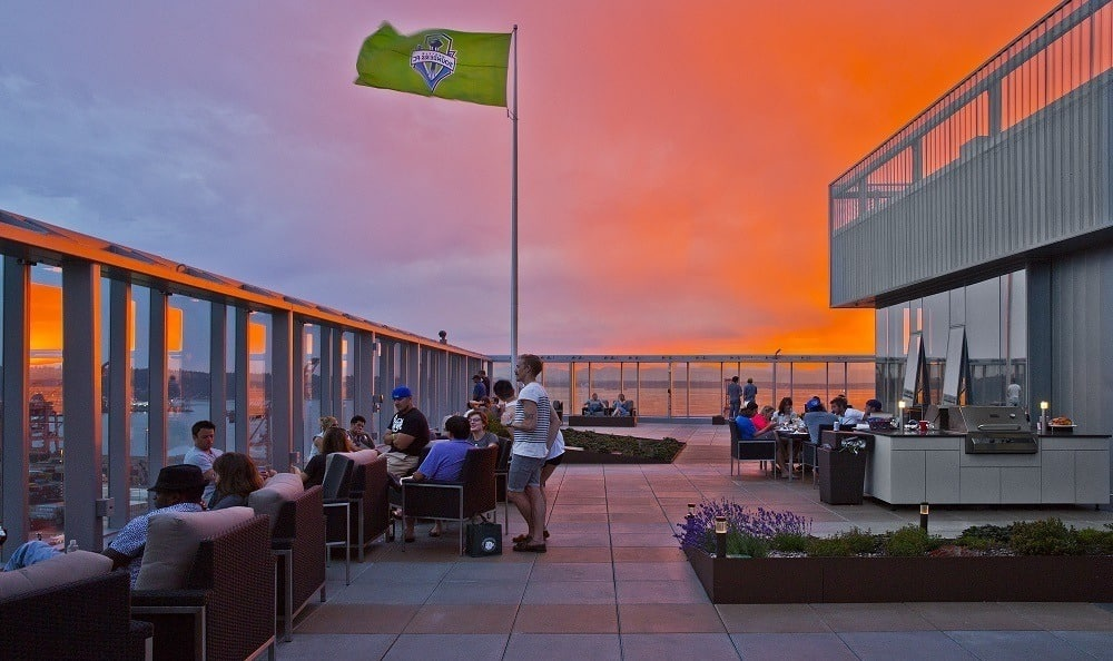 Stunning sunsets from resident roof top view deck at The Wave Seattle WA Apartments