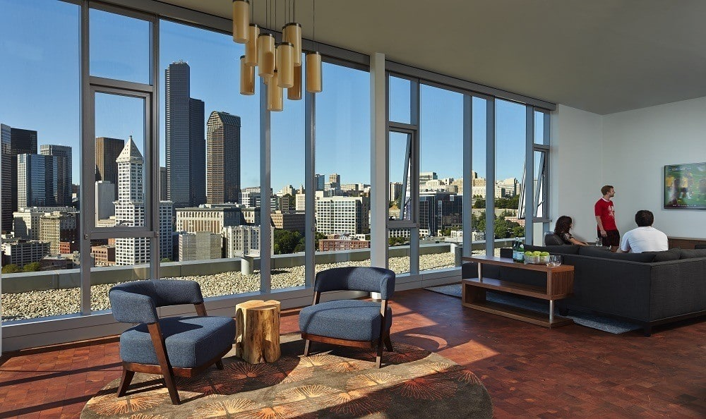 Resident lounge with view of city skyline at The Wave Seattle WA Apartments