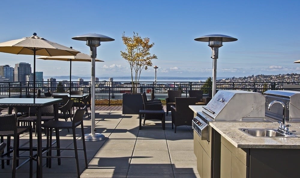 Deck with view of the Space Needle and downtown Seattle The Lyric Apartments
