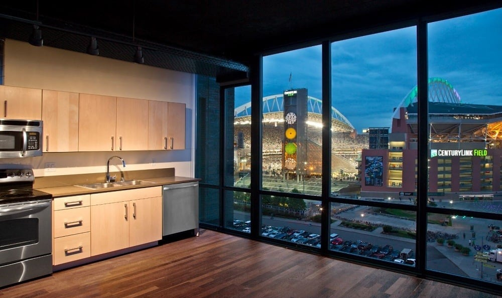 Living room with a stunning view at The Nolo at Stadium Place in Seattle, Washington