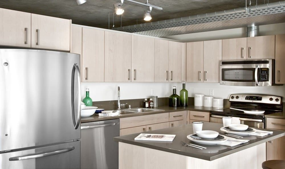 Fully equipped kitchen with a kitchen island at The Nolo at Stadium Place in Seattle, Washington
