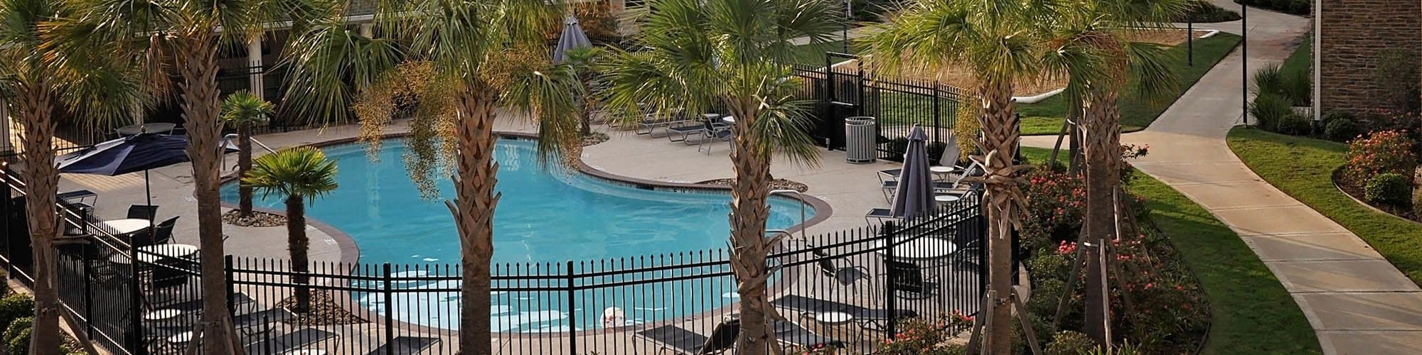 Relax by one of our two pools at Jamestown Place Apartment Homes.