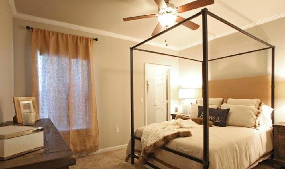 Beautiful master bedroom at Cameron Isles Apartments in Houma, LA