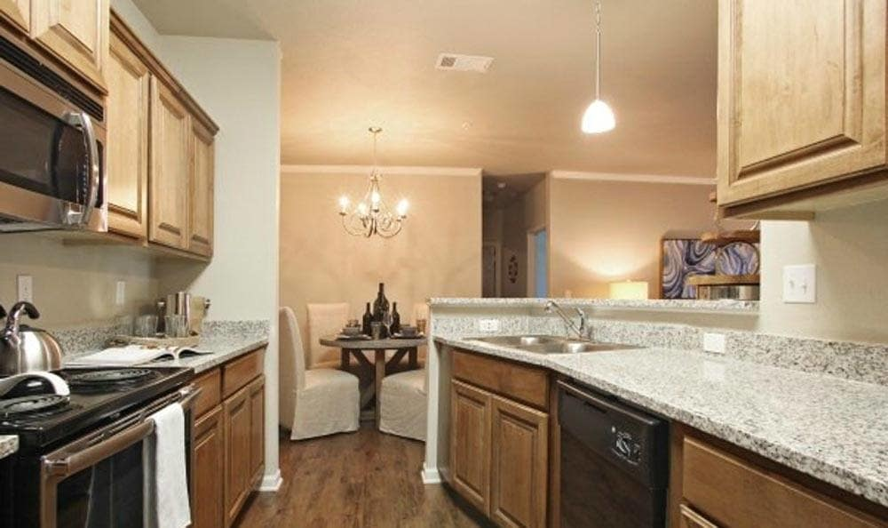 Large island in the kitchens at Cameron Isles Apartments in Houma, LA