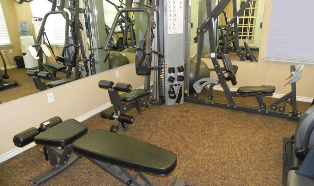 Weight training equipment at Reserve at Squirrel Run in New Iberia, LA