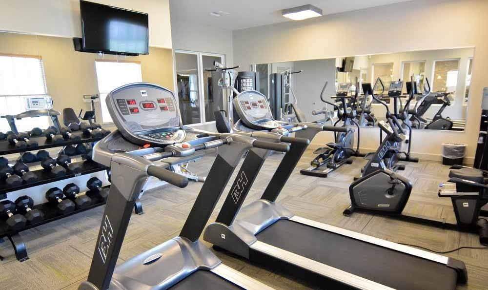 Fitness center at Villa Broussard in Broussard, LA