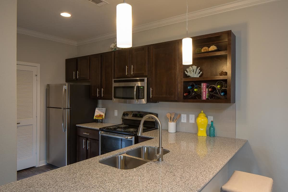 Open concept kitchens at West Woods Apartments in Pensacola, FL