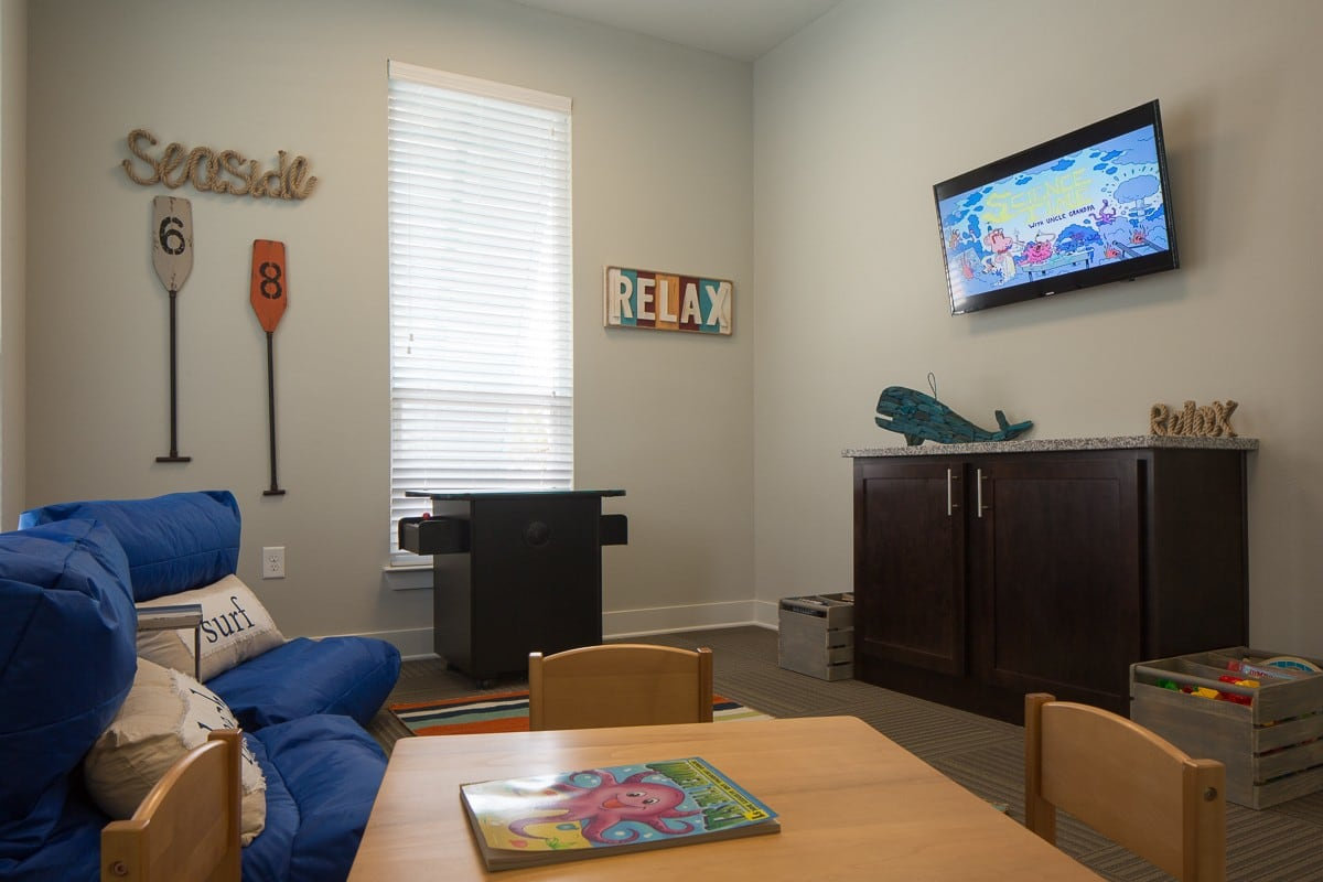 Another example living room at West Woods Apartments in Pensacola, FL