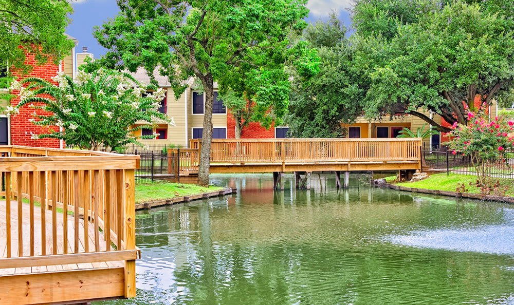 Lake and grounds at apartments in Houston
