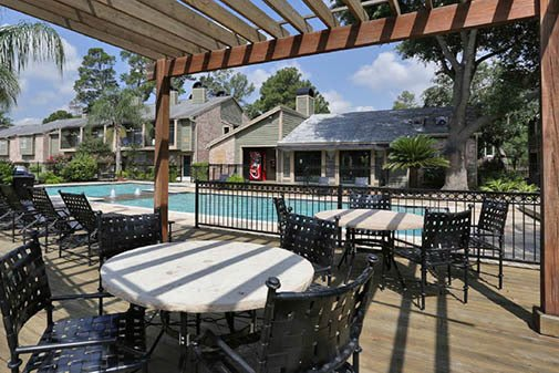 Relazing pool area at affordable apartments in Texas