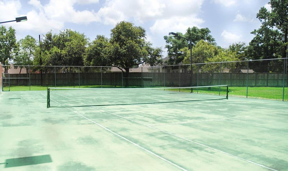 Play at the tennis courts at apartments in Bay City