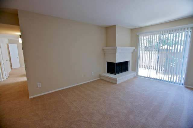 Looking at fireplace in living room of apartment home at Applewood Village Apartments