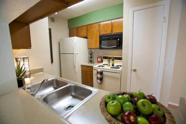 A look at the kitchen inside apartments at Applewood Village Apartments