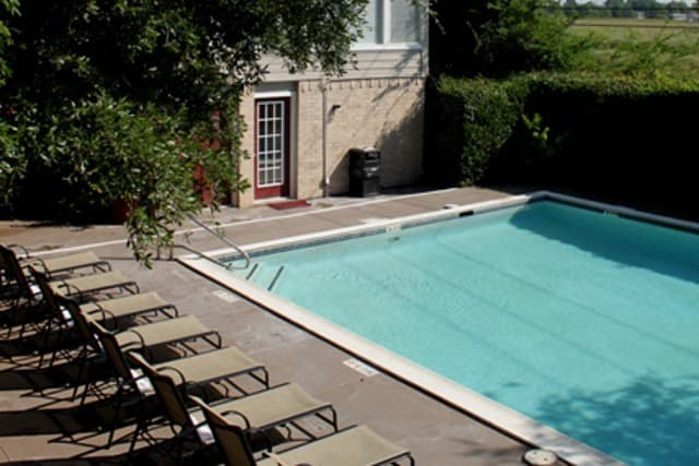 Pool with clubhouse at Century Park Apartments