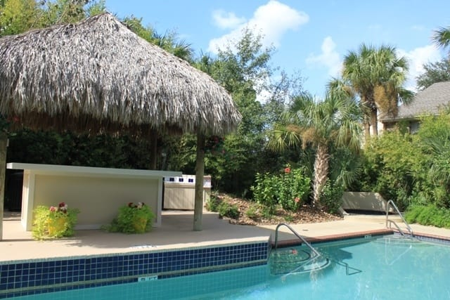 Pool, bar and hot tub at St. Gregory's Beach Apartments