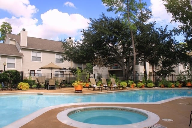 Hot tub and pool at Windsong Village Apartments in Spring