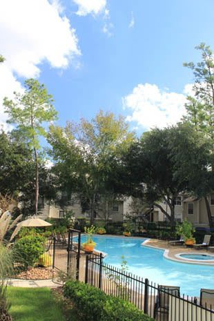 Pool and surrounding courtyard apartments in Spring