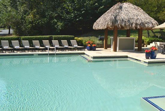Enjoy a dip in the sparkling pool at affordable apartments in NC