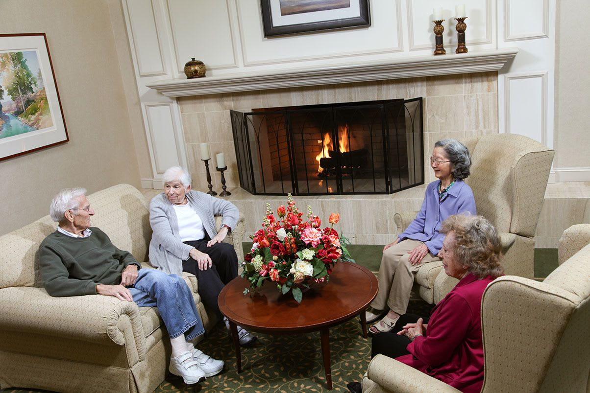 Relax By The Fireplace At Senior Living In Los Altos California