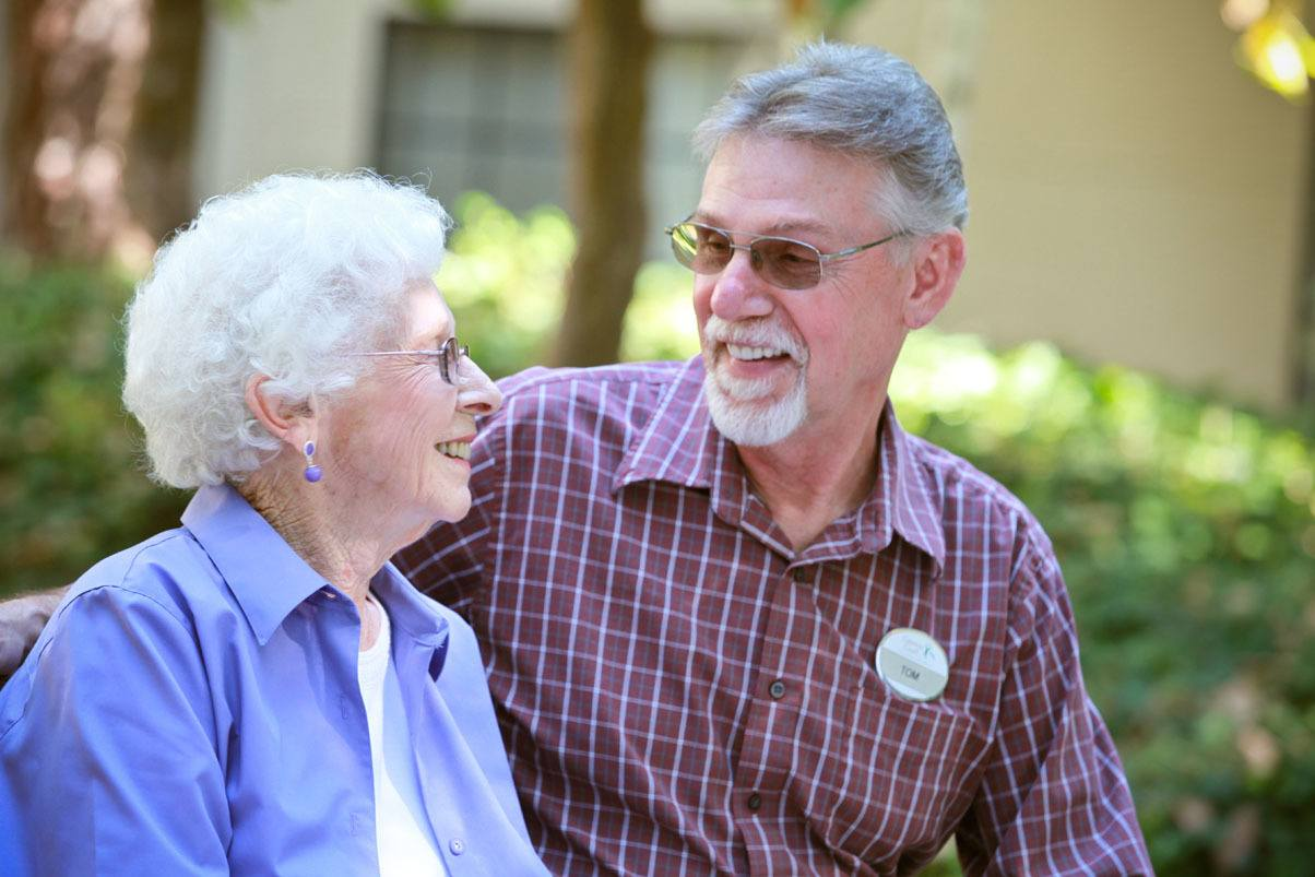 Senior couple laughing at Cypress Court