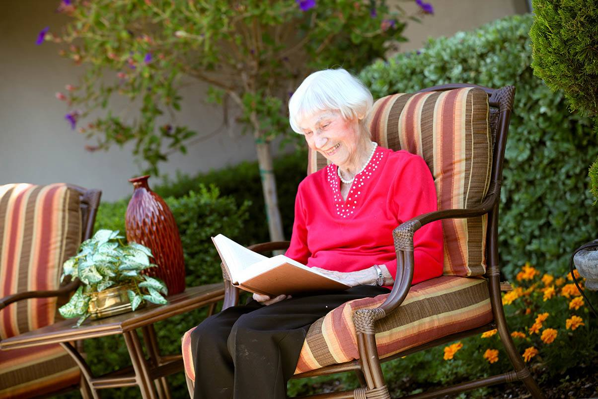 Senior woman enjoying peaceful outdoors at Cypress Court