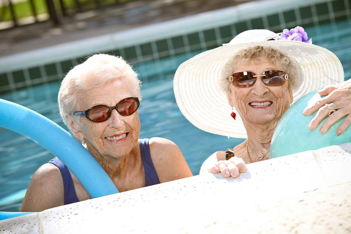 Happy senior women getting exercise in the pool at Park Terrace