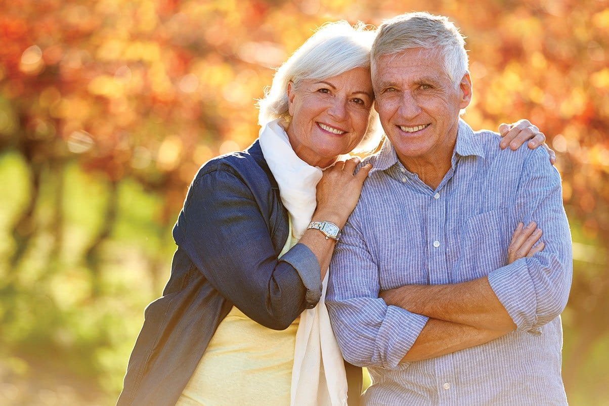 Happy senior couple enjoying the outdoors at Cedarwood at Sandy