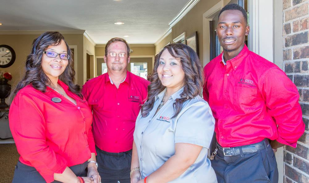 Nolan Real Estate friendly staff at a location