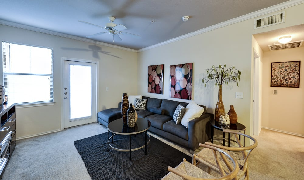 Well-lit living room at Presidio Apartments in Bryan, TX