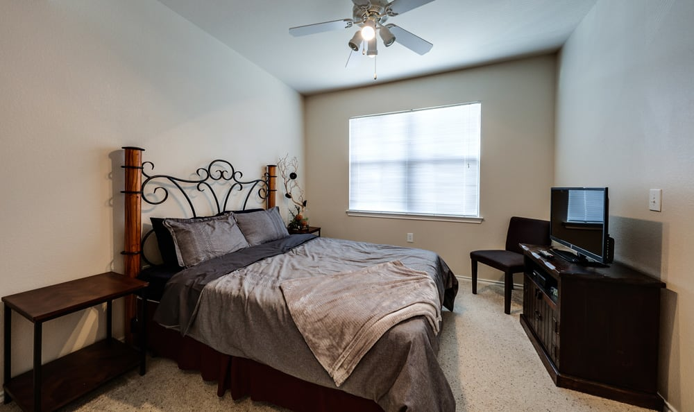 Bedroom with natural light at Presidio Apartments in Bryan, TX