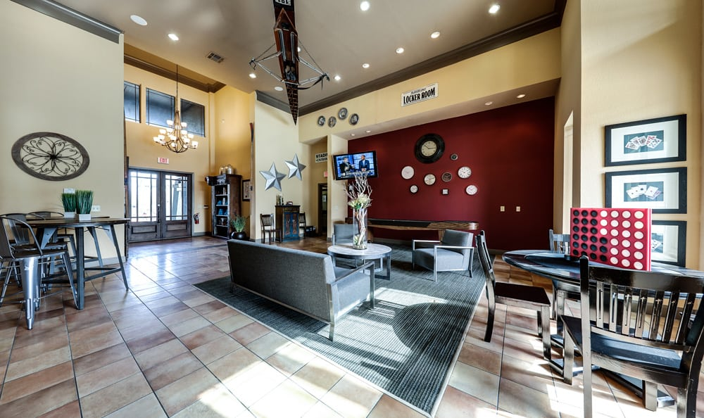 Community room with natural light at Presidio Apartments in Bryan, TX