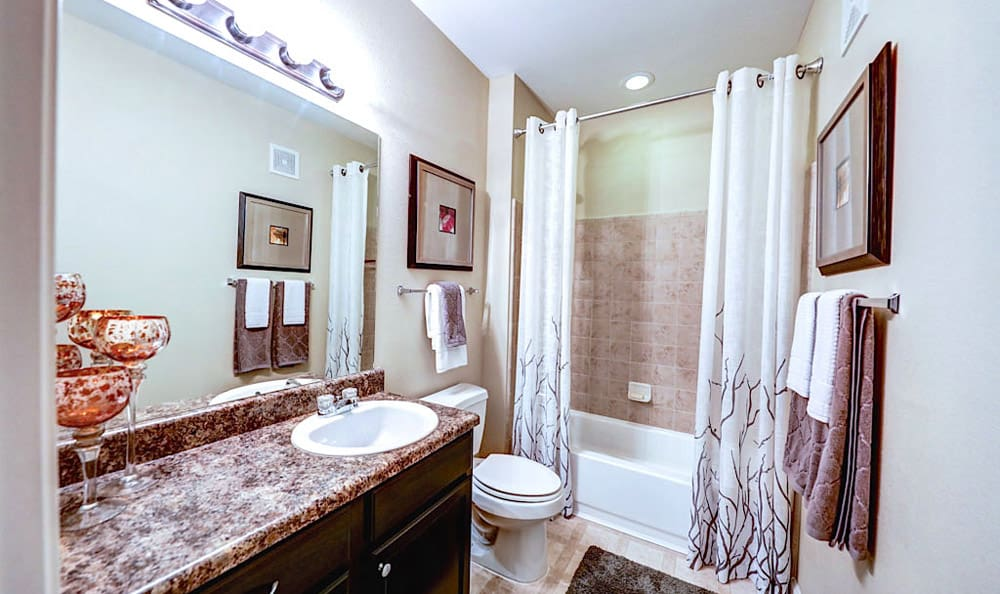 Bathroom with garden style tub at Grand Villas at Tuscan Lakes