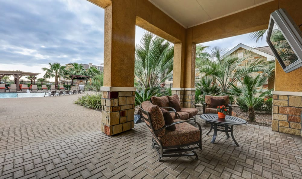 Outdoor seating by the pool at Grand Villas at Tuscan Lakes