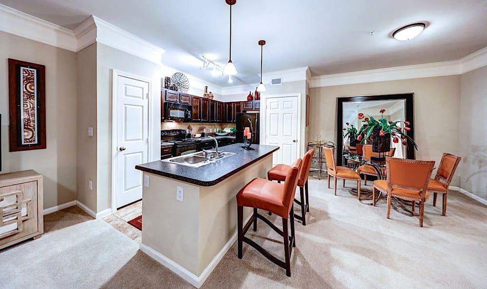 Kitchen Island and dining room at Grand Villas at Tuscan Lakes
