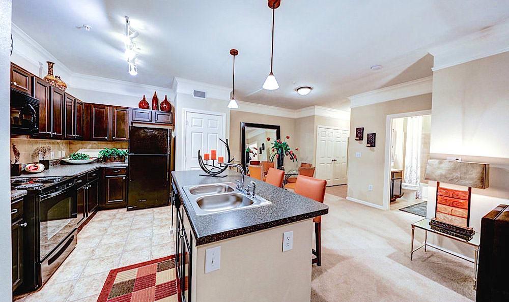 Kitchen looking to living room at Grand Villas at Tuscan Lakes