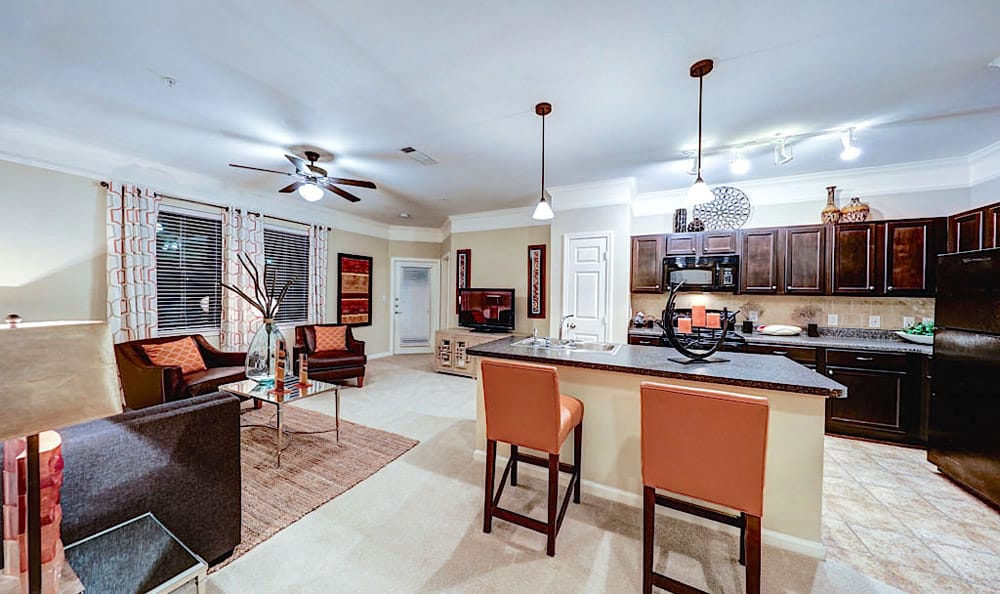 Kitchen with island dining area at Grand Villas at Tuscan Lakes