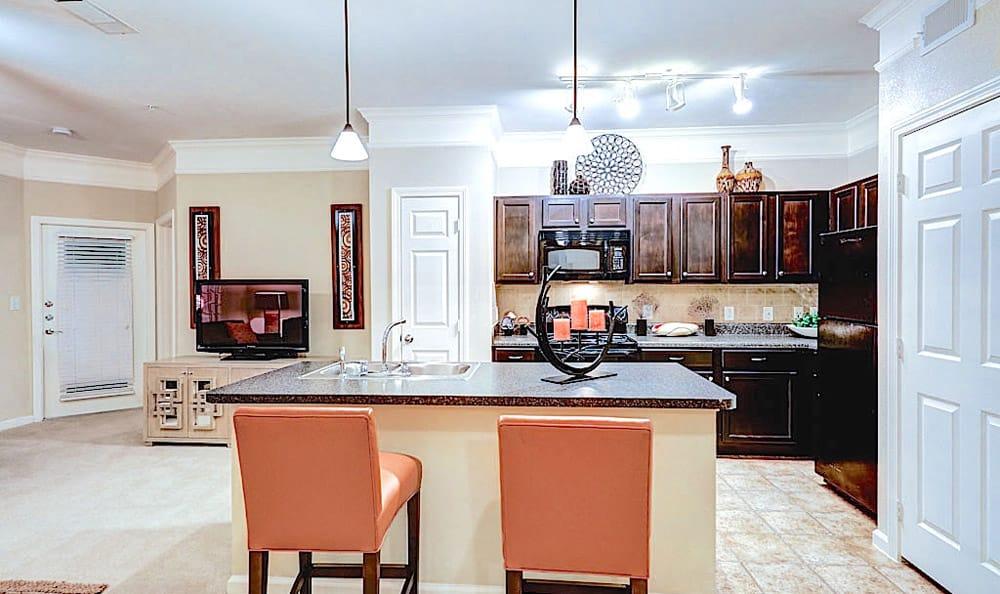 Kitchen with dining island at Grand Villas at Tuscan Lakes